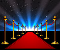 Red carpet to the stars. Red carpet with gold stanchions to the stars Royalty Free Stock Image