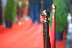 Red carpet -  is traditionally used to mark the route taken by heads of state on ceremonial and formal occasions.  Stock Photography