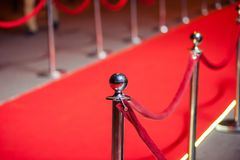 Long Red Carpet -  is traditionally used to mark the route taken by heads of state on ceremonial and formal occasions. Red Carpet -  is traditionally used to stock photos
