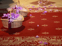 Red carpet with two baskets of petals flowers Royalty Free Stock Photos