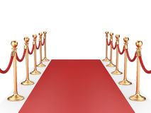 Red carpet between two gold stanchions with rope Royalty Free Stock Images