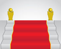 Red carpet and two golden statue Stock Image