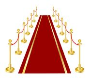 A red carpet and velvet rope with golden brass Royalty Free Stock Photos