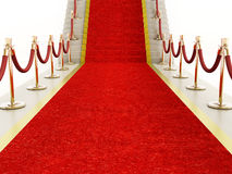 Red carpet and velvet ropes leading to the staircase. Red carpet and velvet ropes leading to a staircase Stock Photos