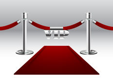 Red Carpet with VIP Sign. Hanging on barrier rope with silver poles Royalty Free Stock Images