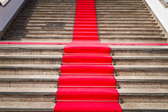 Red carpet way on staircase Stock Photos