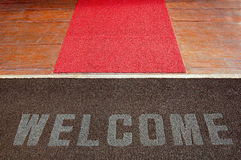 Red carpet welcome. Welcome sign on a hotel entrance path Royalty Free Stock Image