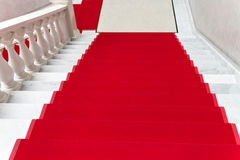 Red carpet on white marble staircase Royalty Free Stock Photography