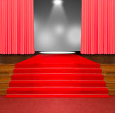 Red carpet on wood stairs. And red curtain with spot light background Royalty Free Stock Photos