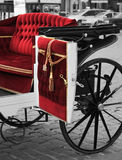 Red carriage. Open door of the splendid red carriage royalty free stock photography