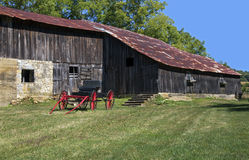 Red carriage and barn. Royalty Free Stock Image