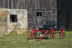 Red Carriage and Barn Stock Photo