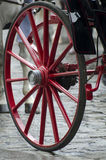 Red carriage wheel Stock Photography