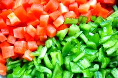 Red carrot and green pepper background. In the image, there are some red carrots and green peppers Stock Photography