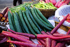 Red carrots and cucumbers freshly. Royalty Free Stock Images