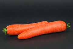 Red carrots. On dark background Royalty Free Stock Image