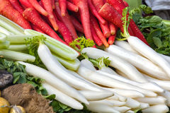 Red carrots and reddish in market. Red carrots and pilled reddish at Indian market Stock Images