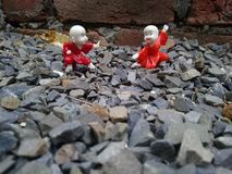 Cartoon characters. Red cartoon character fight at the stone click royalty free stock photos