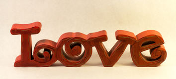Red Carved Wooden Love Sign Stock Photography