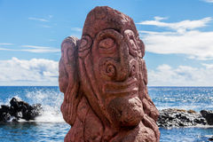 Red carving on a moai in Easter Island. Red carving of a scary face on a moai in Easter Island royalty free stock photography