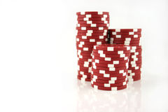 Red Casino Chips 3 Part Stacks. 3 part stacks of red casino chips isolated on a white background Stock Images
