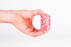 Red casino chips on human hands isolated on white Stock Image