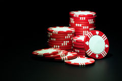 Red casino chips. Stacks of red casino poker chips over black background royalty free stock photos