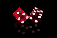 Red Casino Dice. Pair of red casino gaming/gambling dice from Las Vegas, Nevada on a black background with reflection royalty free stock images