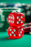 The red casino dice and casino chips Royalty Free Stock Photos