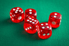 The red casino dice. On green table royalty free stock image