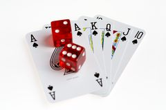 Red Casino Dice on Poker Hand. Red Casino dice on Ace High Running Flush Poker Hand stock images