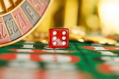 Red casino dice. On the table Stock Photo