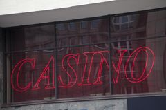 Red casino sign in the window. Red casino sign in the dark window Royalty Free Stock Image