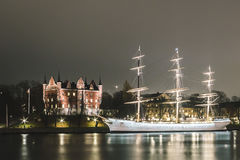 Red Castle and a Boat at Night in Stockholm, Sweden Stock Photography