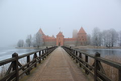 Red Castle Misty Wooden Bridge Winter Ice. Red Castle And Wooden Bridge In Winter stock image