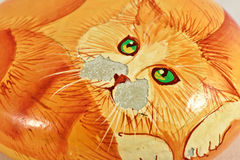 Red cat curled up. Old painting on stone Stock Photo