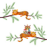 Red cat lays on Christmas tree branch. Nearby sit the birds. Sty Royalty Free Stock Image