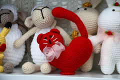 Red cat from threads. In the foreground among other toys there is a figure of a cat made of red threads royalty free stock images