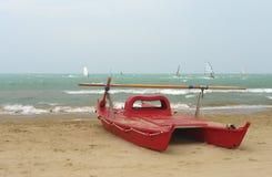 Red catamaran at the beach Royalty Free Stock Photo