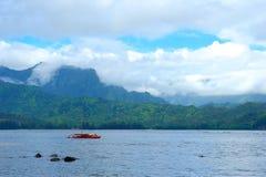 A Red Catamaran Off the Coastline of Kauaii Royalty Free Stock Image