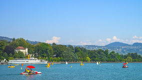 Red catamaranas and other water transport in Geneva Lake in Laus Stock Photo