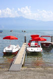 Red catamarans in Geneva lake bay harbor in Lausanne, Switzerlan Royalty Free Stock Images