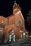 Red Catholic church in the center of Minsk at night Stock Photo