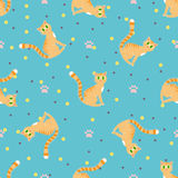 Red cats seamless pattern. Sitting red cat on a blue background with paw print vector illustration