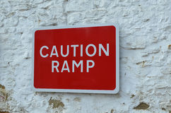 Red caution ramp sign. Stock Photos