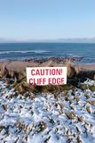 Red caution sign on a cliff edge Stock Photos
