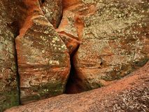 Red cave and stones. Red cave in the deep forest Stock Photo