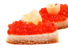 Red Caviar. Butter end white bread on a white background Royalty Free Stock Image