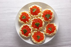 Red caviar. Caviar on little pieces of bread with butter Stock Images