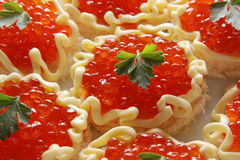 Red caviar. Caviar on little pieces of bread with butter Royalty Free Stock Photography